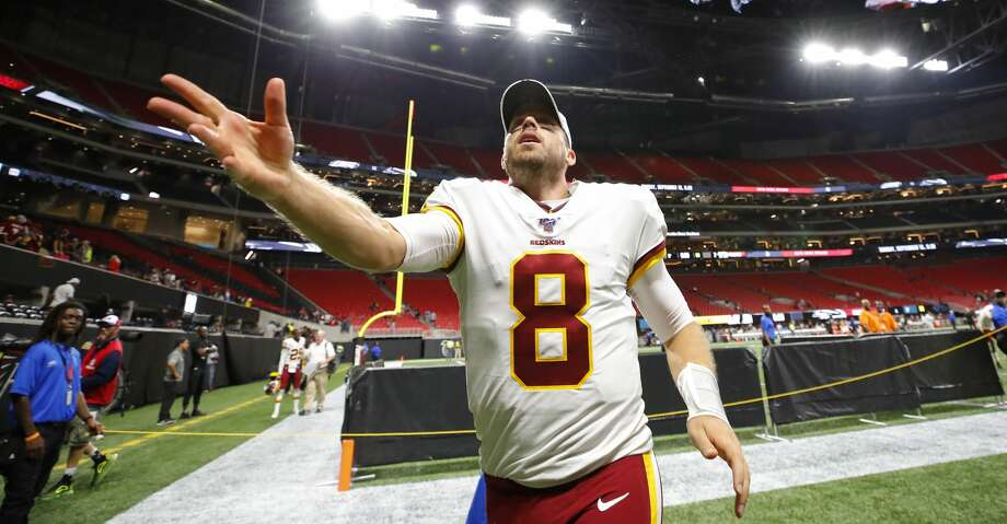 ATLANTA, GA - AUGUST 22: Quarterback Case Keenum #8 of the Washington Redskins throw his gloves to fans at the conclusion of an NFL preseason game against the Atlanta Falcons at Mercedes-Benz Stadium on August 22, 2019 in Atlanta, Georgia. (Photo by Todd Kirkland/Getty Images) Photo: Todd Kirkland/Getty Images