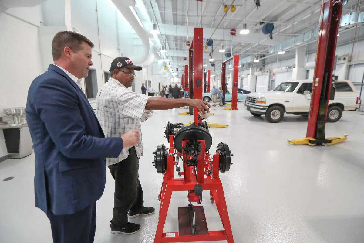 Toby Gustavus (left) talks with D. Phillips during a tour of the Houston Community College North Forest campus' training garageTuesday, Aug. 6, 2019, in Houston.
