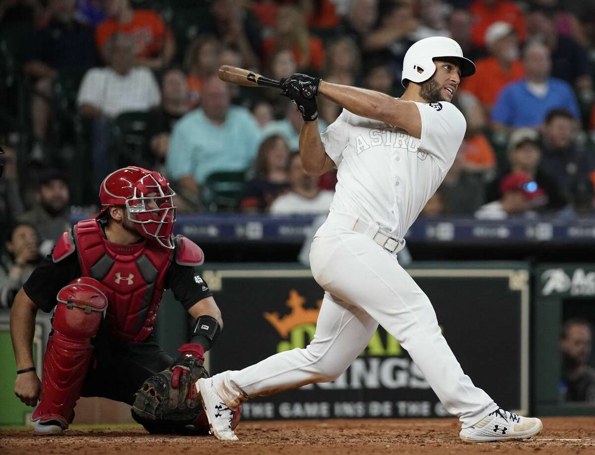 Houston Astros Abraham Toro singles in a run against Los Angeles Angels during the eighth inning of MLB game at Minute Maid Park Sunday, Aug. 25, 2019, in Houston. Alex Bregman scored on the hit.