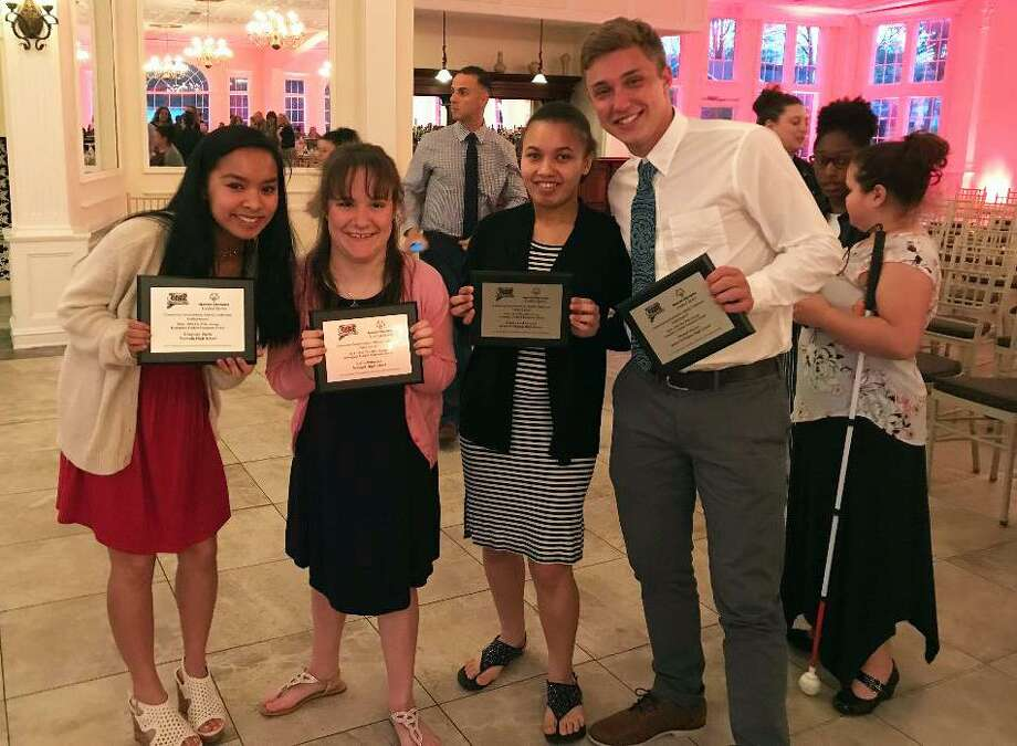 Elizabeth Burke, Emily Billmeyer, Noelia Baker Ortiz and Michael Macari receive awards at the Aquaturf on April 30 for their participation and dedication to the Unified Sports programs at McMahon and Norwalk. Burke and Baker Ortiz participate as student-athletes, while Billmeyer and Macari are their unified partner. Photo: Contributed Photo / Stamford Advocate Contributed