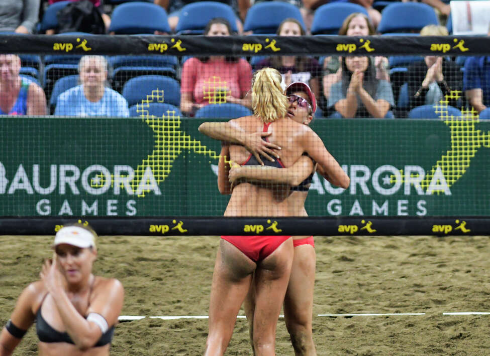 Alix Klineman of the U.S., and her teammate April Ross, embrace after winning the championship of the beach volleyball against the Czech Republic at the Aurora Games at the Times Union Center on Sunday, Aug. 25, 2019, in Albany, N.Y. (Paul Buckowski/Times Union)