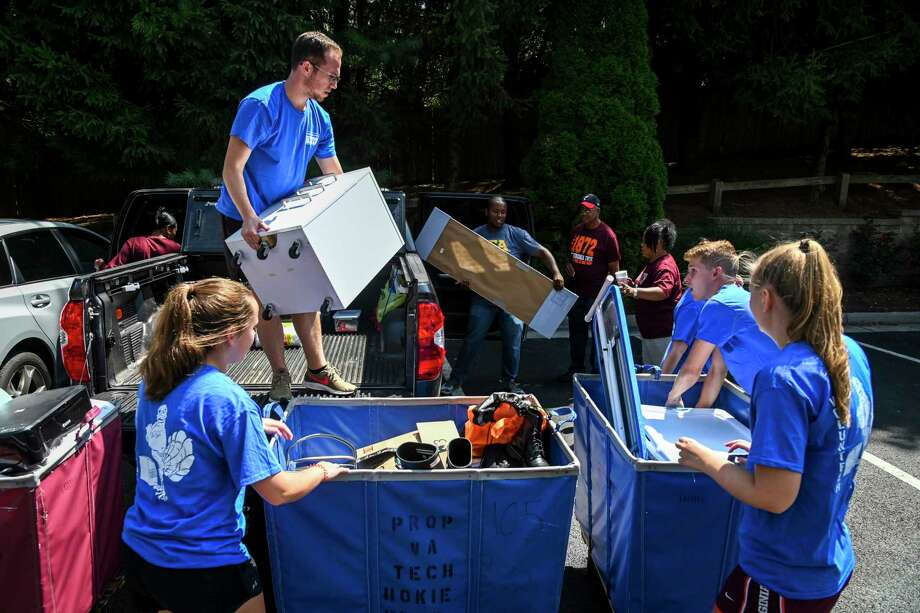 Volunteers help incoming freshman Rionna Luck's family unload the belongings of the student to be moved into HIE (Holiday Inn Express) student housing near Virginia Tech University on Wednesday, Aug. 21, 2019, in Blacksburg, Virginia. The hotel has been leased by the university for dorm rooms because Virginia Tech has seen a surge in enrollment and is facing a student housing crunch. The university is leasing two nearby motels to house students and has a dorm under construction. Photo: Washington Post Photo By Jahi Chikwendiu. / The Washington Post