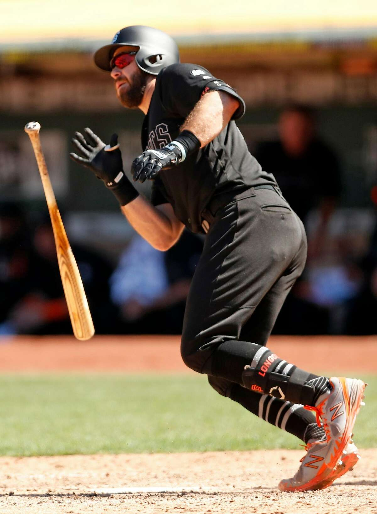 San Francisco Giants' Evan Longoria watches his go-ahead 2-run single in 7th inning against Oakland Athletics during MLB game at Oakland Coliseum in Oakland, Calif., on Sunday, August 25, 2019.