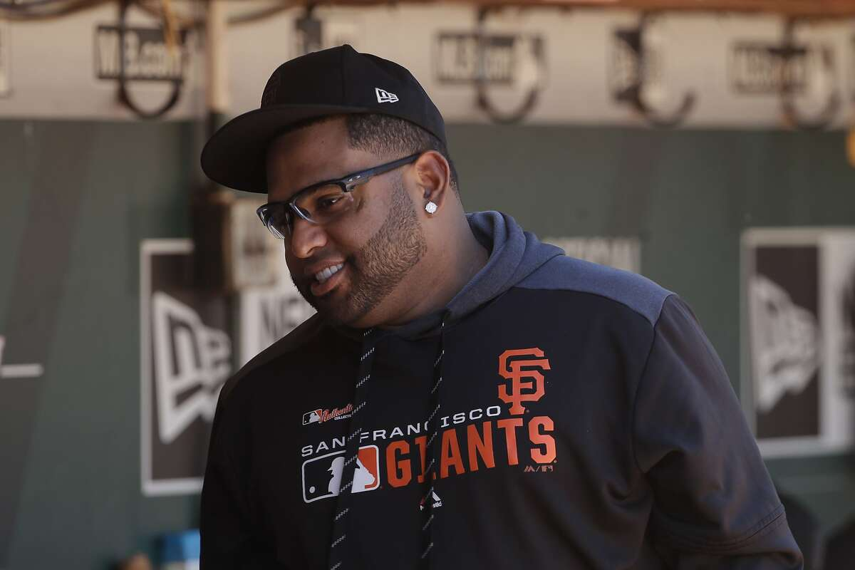 San Francisco Giants' Pablo Sandoval walks in the dugout during a baseball game against the Oakland Athletics in Oakland, Calif., Sunday, Aug. 25, 2019. (AP Photo/Jeff Chiu)