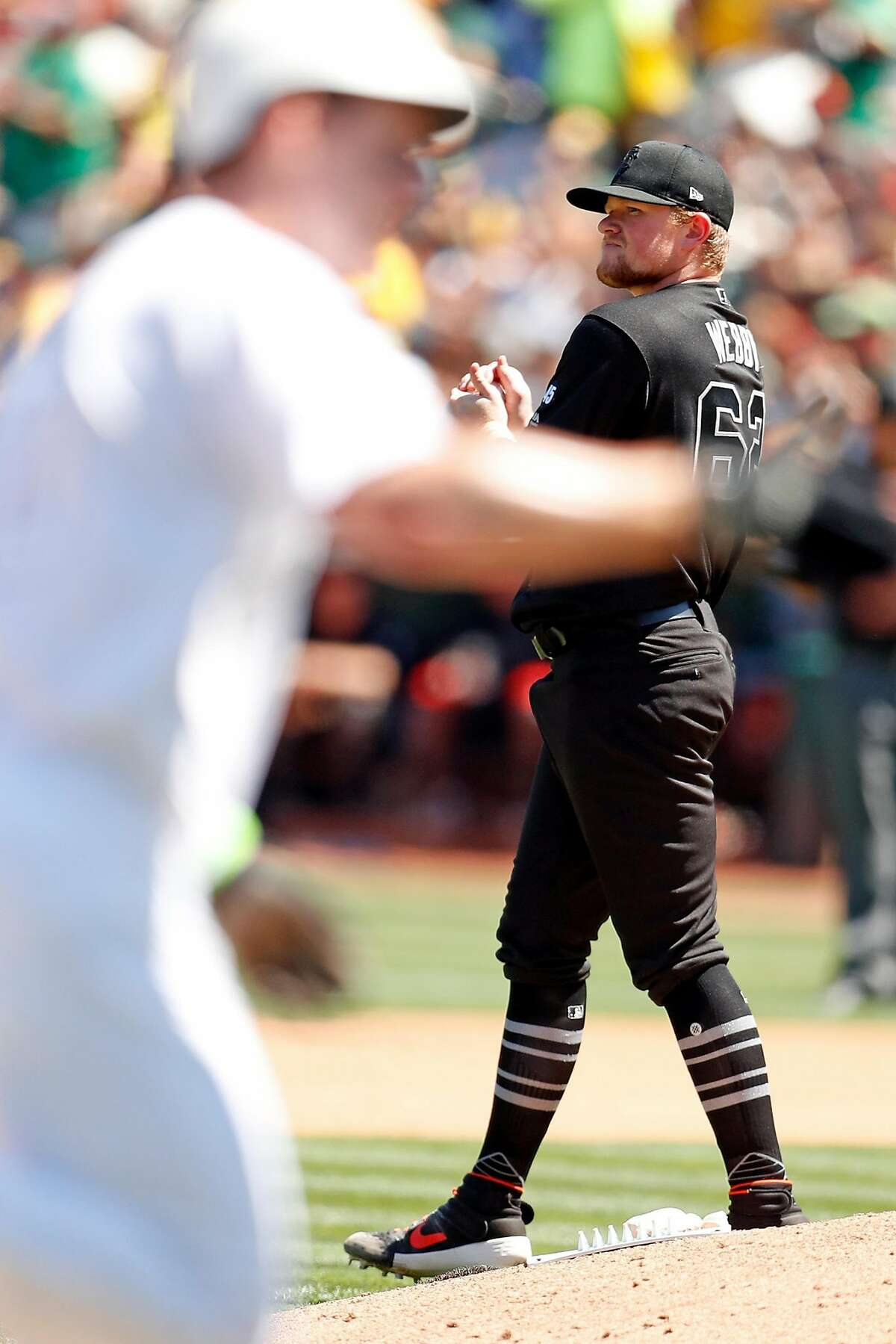 San Francisco Giants' starting pitcher Logan Webb looks away in the 4th inning as Oakland Athletics' Mark Canha rounds the bases after his second solo home run of the game during MLB game at Oakland Coliseum in Oakland, Calif., on Sunday, August 25, 2019.