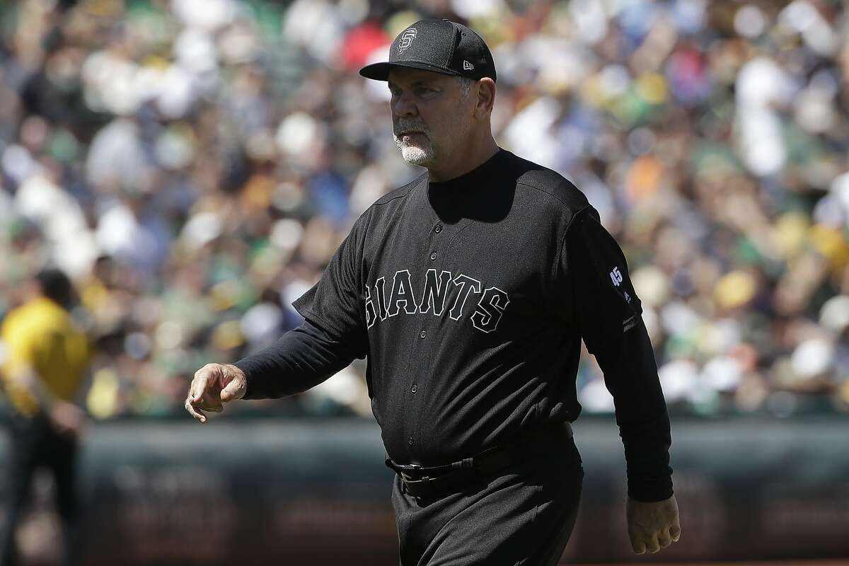 San Francisco Giants manager Bruce Bochy walks toward the dugout after making a pitching change against the Oakland Athletics during the fifth inning of a baseball game in Oakland, Calif., Sunday, Aug. 25, 2019. (AP Photo/Jeff Chiu)