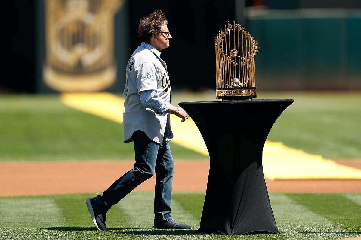 Oakland Athletics' Tony LaRussa walks to podium during ceremony honoring 1989 World Series champions before A's played San Francisco Giants in MLB game at Oakland Coliseum in Oakland, Calif., on Sunday, August 25, 2019.