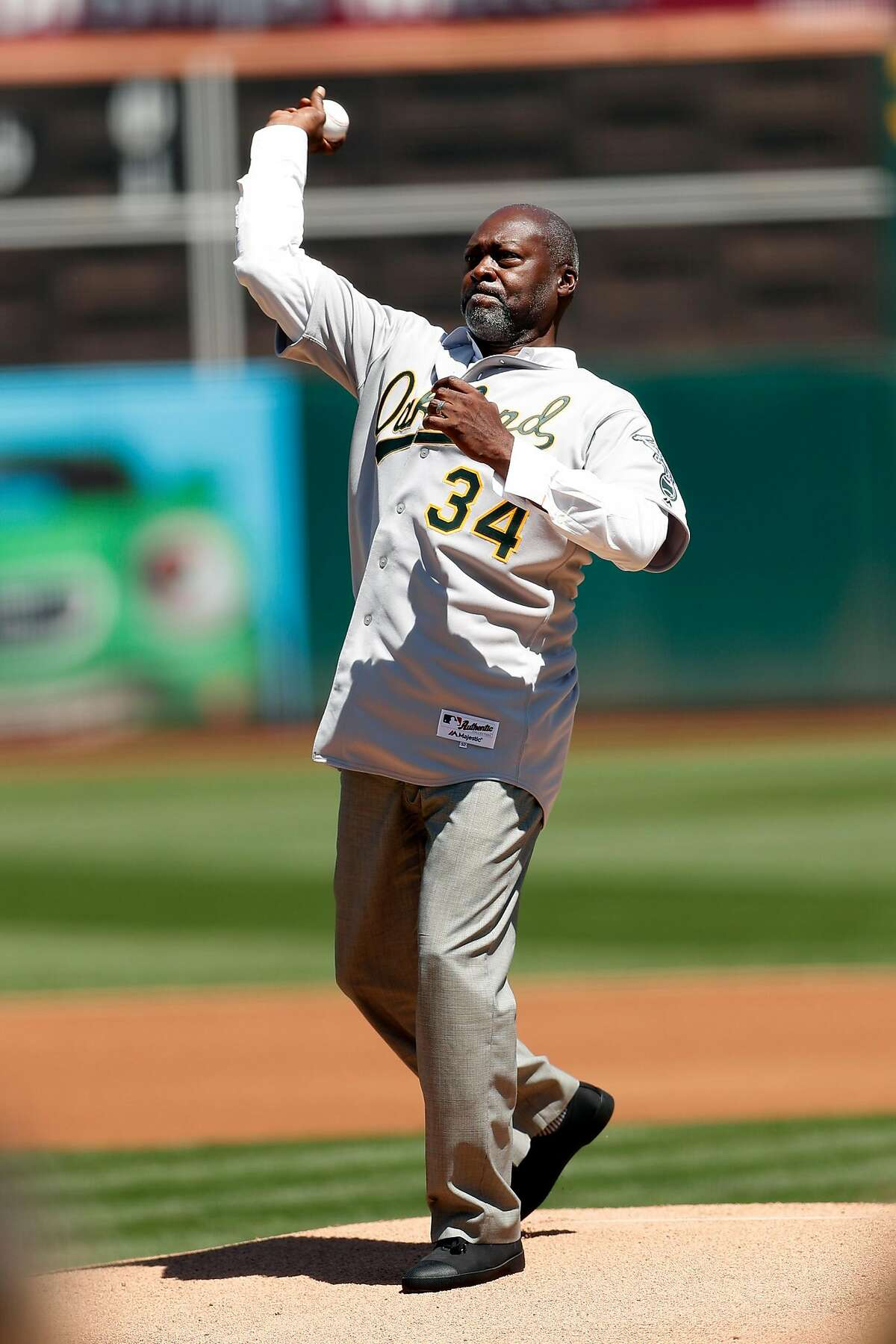 Oakland Athletics' Dave Stewart throws out first pitch during ceremony honoring 1989 World Series champions before A's played San Francisco Giants in MLB game at Oakland Coliseum in Oakland, Calif., on Sunday, August 25, 2019.