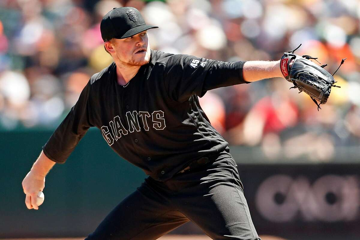 San Francisco Giants' Logan Webb pitches in 1st inning against Oakland Athletics during MLB game at Oakland Coliseum in Oakland, Calif., on Sunday, August 25, 2019.