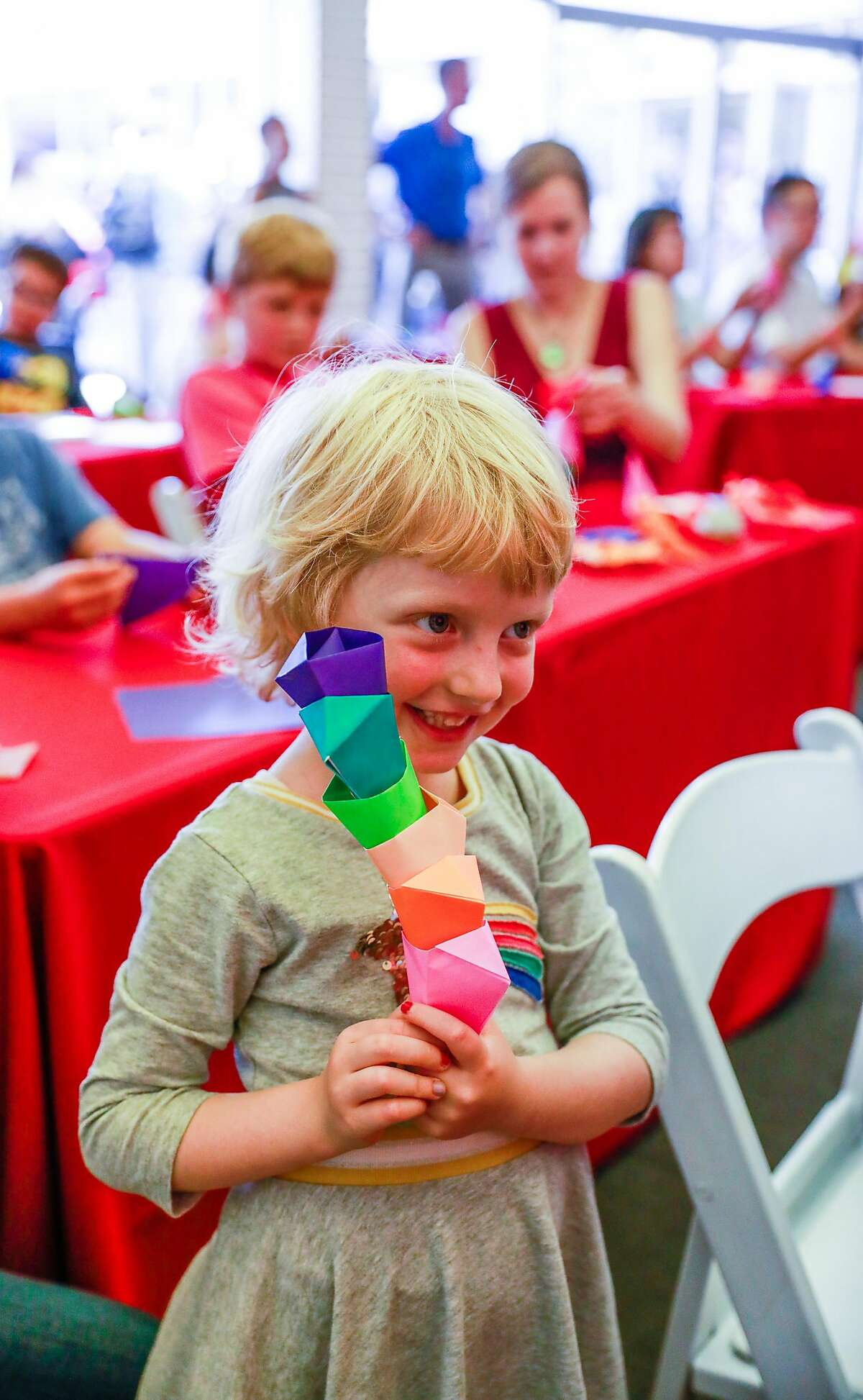 Eden Martin, 5 stacks her origami cones during a class taught by famous origamist Jeremy Shafer (not pictured) at the Origami Palooza in Japantown in San Francisco, California, on Sunday, Aug. 25, 2019.