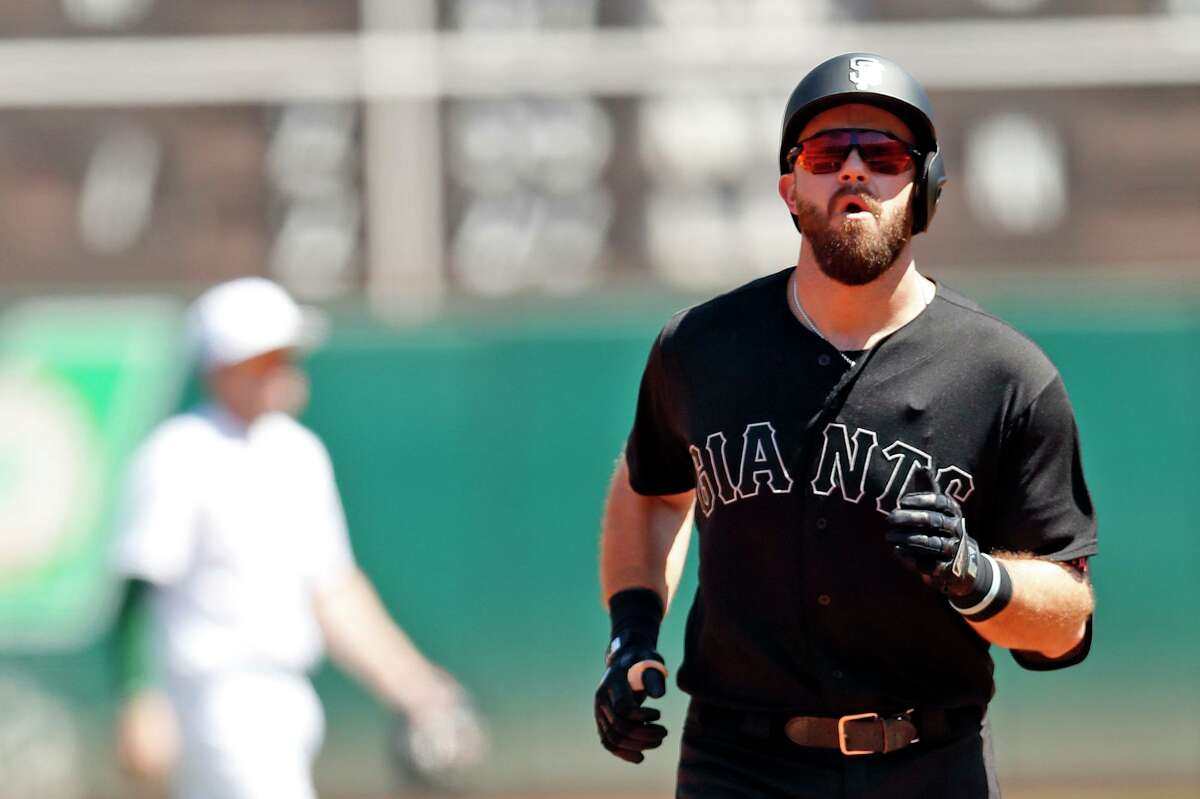 San Francisco Giants' Evan Longoria rounds the bases after solo home run in 3rd inning during MLB game at Oakland Coliseum in Oakland, Calif., on Sunday, August 25, 2019.