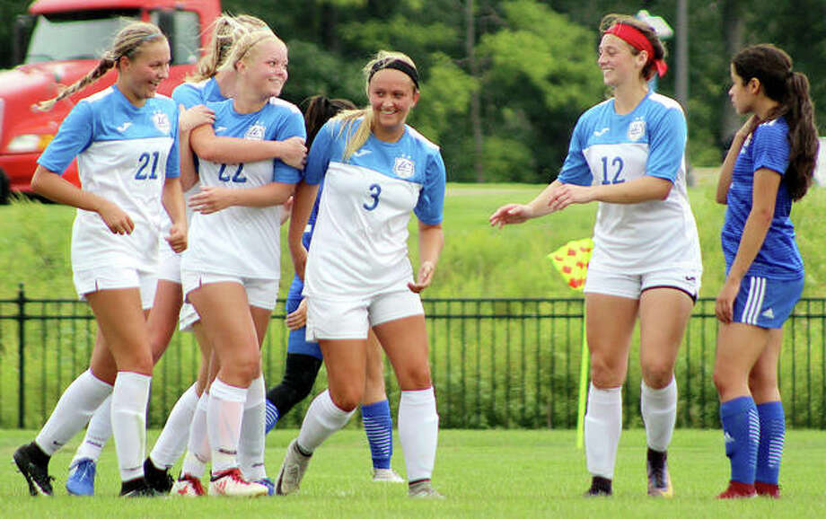 LCCC's Jocelyn Wagner (22) is congratulated after scoring a goal by teammates Emma Lucas (21), Payton Corley (3) and Cassie Hall (12) as Norma Garcia of Iowa Lakes looks on Sunday at LCCC. Photo: Pete Hayes | The Telegraph