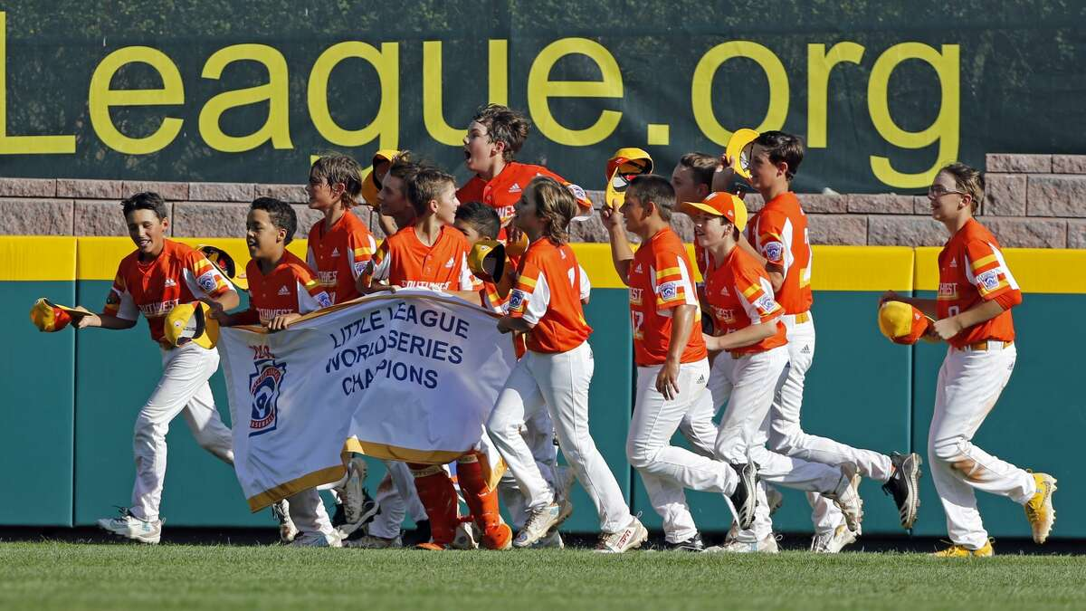 River Ridge, Louisiana's Alton Shorts, River Ridge, Louisiana's Stan Wiltz, Ryder Planchard and Derek DeLatte carry the championship banner around the stadium as they celebrate the 8-0 win against Curacao in the Little League World Series Championship baseball game in South Williamsport, Pa., Sunday, Aug. 25, 2019. (AP Photo/Tom E. Puskar)