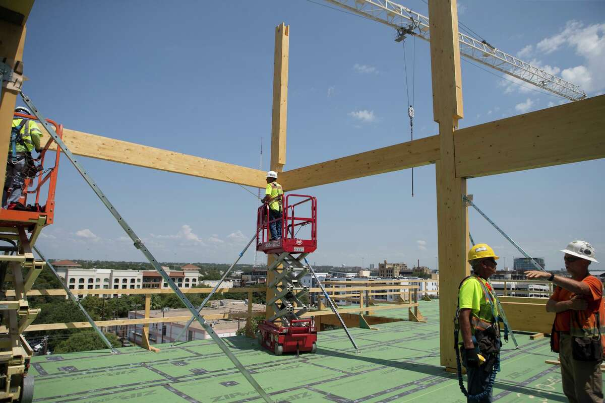 A construction crew works on the Soto, an office building at Broadway and Eighth streets downtown, on Aug. 15, 2019. The Soto is the first large-scale mass timber project in Texas, a method said to be better for the environment.