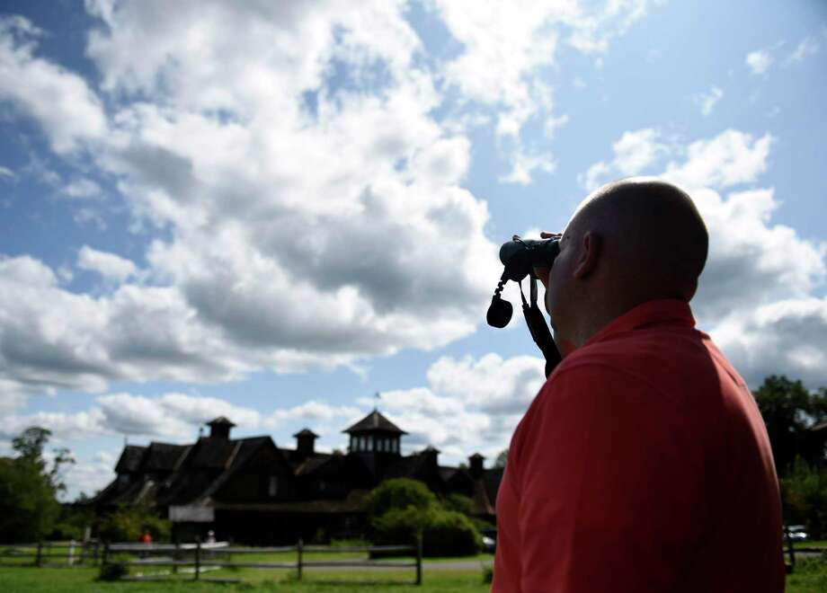 Jason Grippo, of Rye Brook, N.Y., watches hawks through binoculars. The Greenwich Audubon Center will hold its 21st annual Fall Festival & Hawk Watch from 12:30 to 5:30 p.m. Sunday to celebrate the fall migration season. There will be raptor shows, wildlife releases, games, crafts, hayrides, rock climbing wall, food trucks, music and more. The event coincides with the migration season for the thousands of raptors that pass over the center. Admission is $10 formembers, $15 for nonmembers, and children 2 and under are free. For details and to register, visit greenwich.audubon.org/fall-festival-and-hawk-watch. Photo: Tyler Sizemore / Hearst Connecticut Media / Greenwich Time