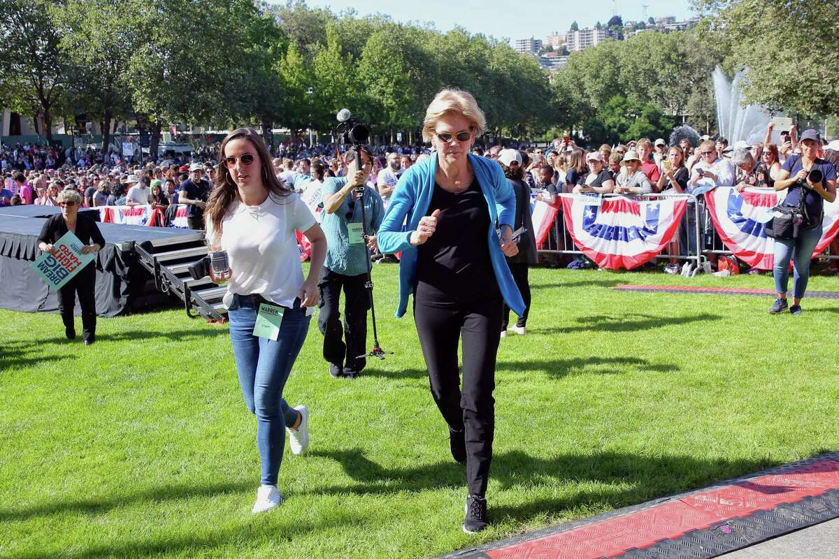 On a roll: Democratic presidential candidate Senator Elizabeth Warren runs off stage following her town hall campaign event at Seattle Center, Sunday, Aug. 25, 2019. Warren is the first top tier candidate to hold a campaign event in Seattle.