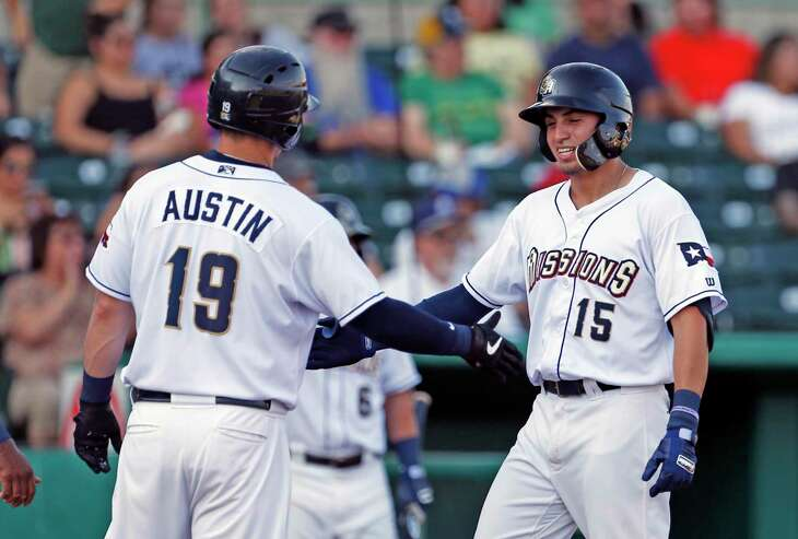Missions Tyrone Taylor celebrates with Tyler Austin after his three run home run in the first inning. The San Antonio Missions are hosting the Oklahoma City Dodgers Sunday on August 25, 2019 at Wolff Stadium
