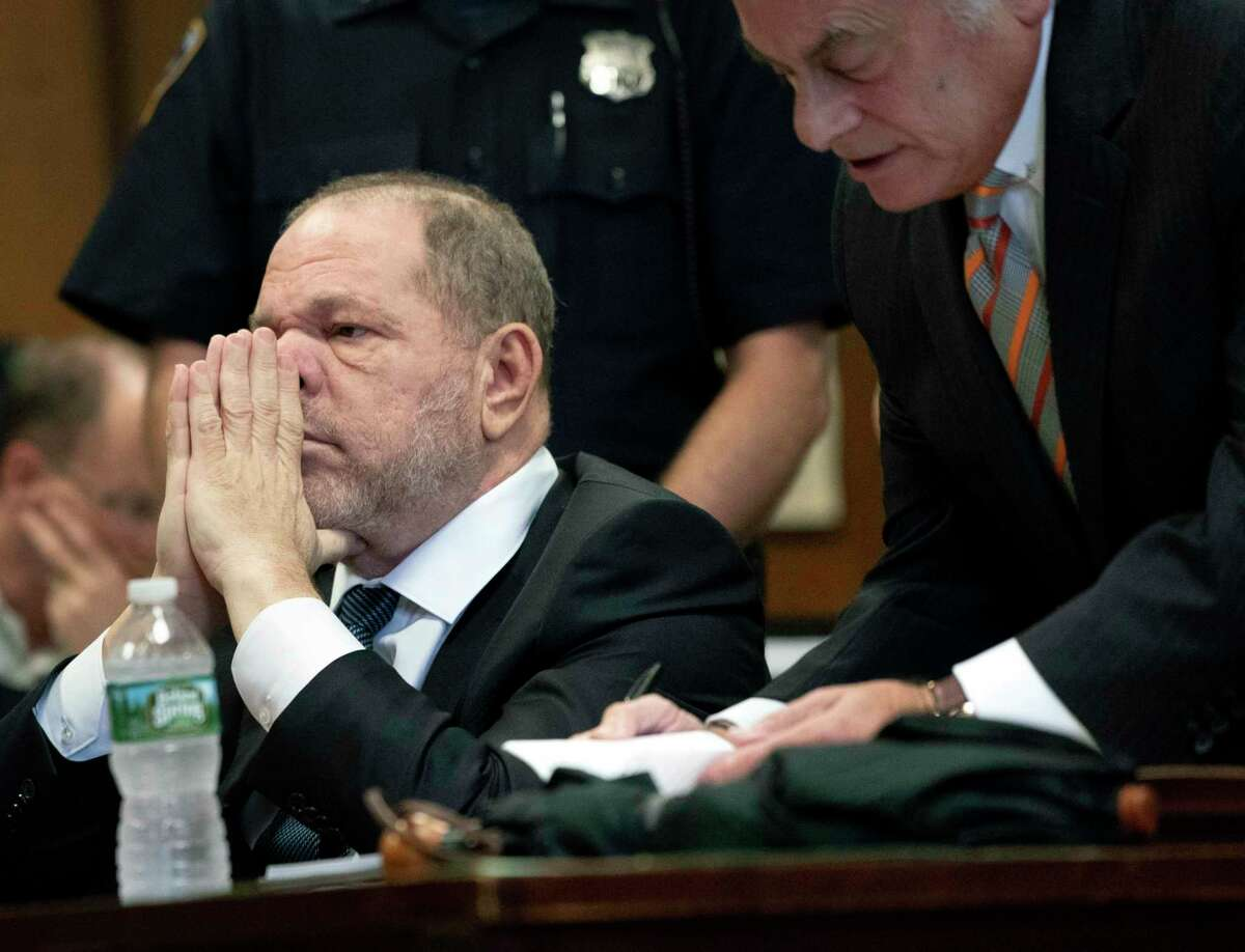 Harvey Weinstein, left, and his attorney Benjamin Brafman attend a hearing in New York, Thursday, Oct. 11, 2018. Manhattan's district attorney dropped part of the criminal sexual assault case against Weinstein on Thursday after evidence emerged that cast doubt on the account one of his three accusers provided to the grand jury. (Steven Hirsch /New York Post via AP, Pool)