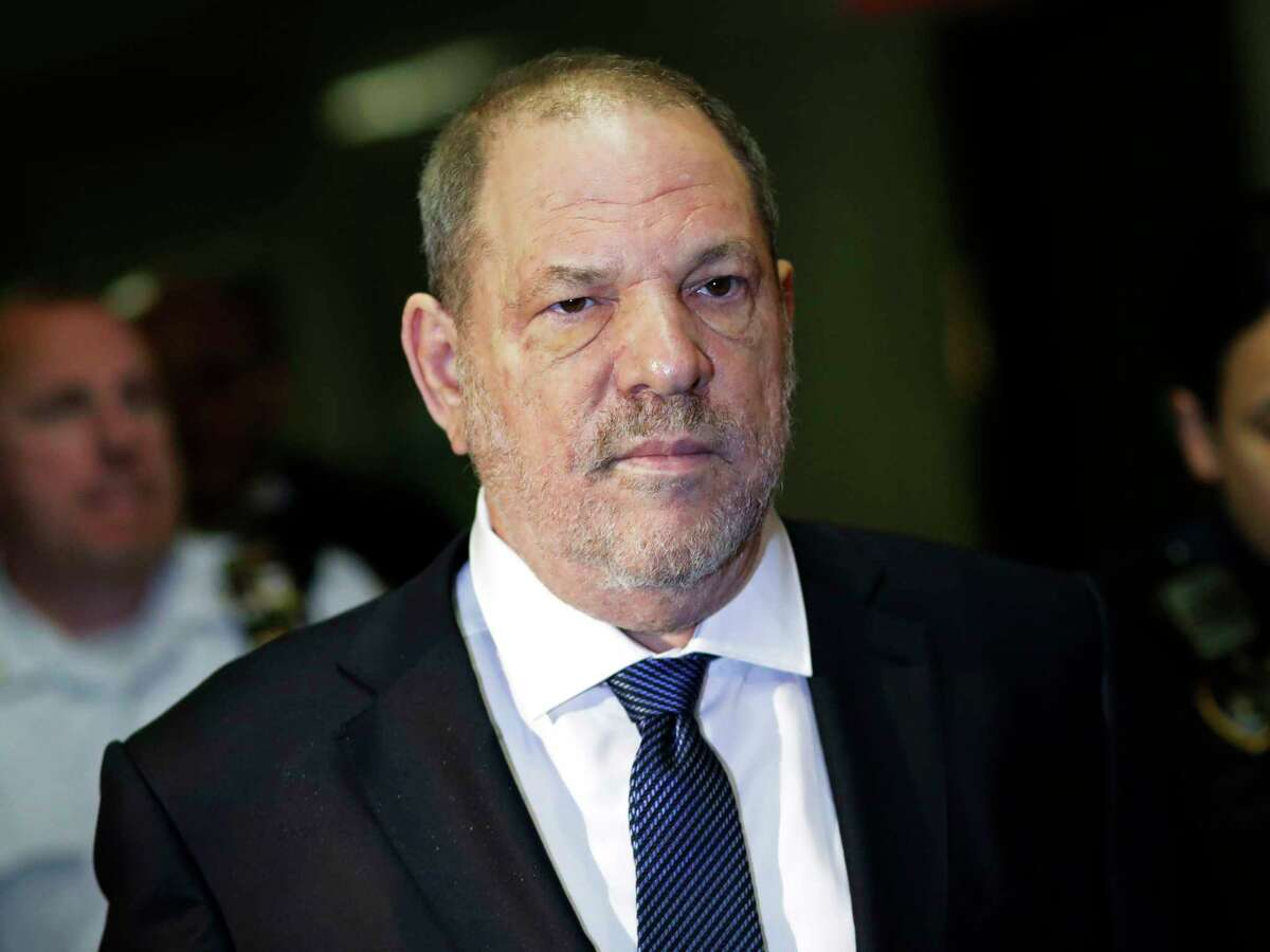 FILE - In this Oct. 11, 2018, file photo, Harvey Weinstein enters State Supreme Court in New York. Weinsteina€™s lawyers want the trial over the sexual assault case against the disgraced movie mogul moved from New York City to Long Island or upstate New York because of a blizzard of pretrial publicity. An appeals court could rule on the request as early as Monday, Aug. 26, 2019. (AP Photo/Mark Lennihan, File)