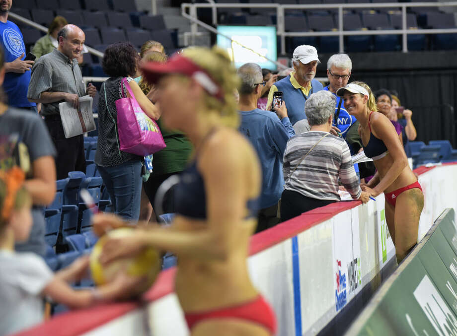 Team U.S. beach volleyball players, April Ross, foreground, and Alix Klineman, background, talk with fans after winning the championship at the Aurora Games at the Times Union Center on Sunday, Aug. 25, 2019, in Albany, N.Y.    (Paul Buckowski/Times Union) Photo: Paul Buckowski / (Paul Buckowski/Times Union)