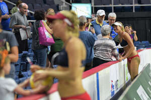 Team U.S. beach volleyball players, April Ross, foreground, and Alix Klineman, background, talk with fans after winning the championship at the Aurora Games at the Times Union Center on Sunday, Aug. 25, 2019, in Albany, N.Y.    (Paul Buckowski/Times Union)