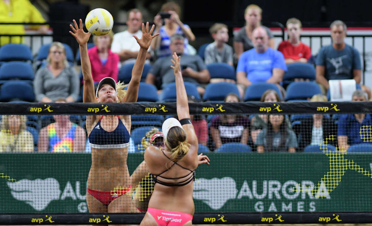 Alix Klineman of the U.S., left, goes up to block the shot of Barbora Hermannova of the Czech Republic during the beach volleyball championship event at the Aurora Games at the Times Union Center on Sunday, Aug. 25, 2019, in Albany, N.Y. (Paul Buckowski/Times Union)