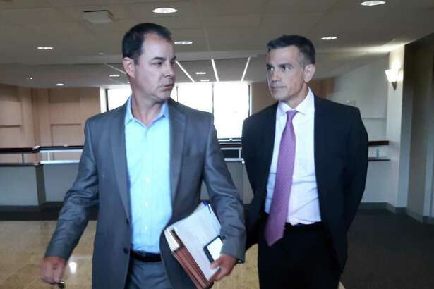 Fotis Dulos, right, arrives with his attorney William Murray last week to be deposed in his mother-in-law's civil lawsuit.