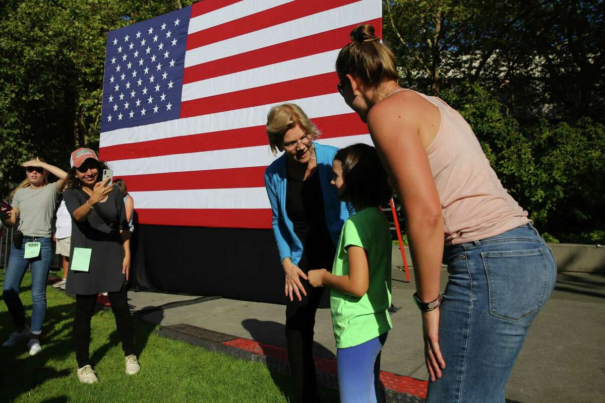 Democratic presidential candidate Senator Elizabeth Warren takes the 50,000th selfie of her campaign after a town hall event at Seattle Center, Sunday, Aug. 25, 2019. Warren is the first top tier candidate to hold a campaign event in Seattle.