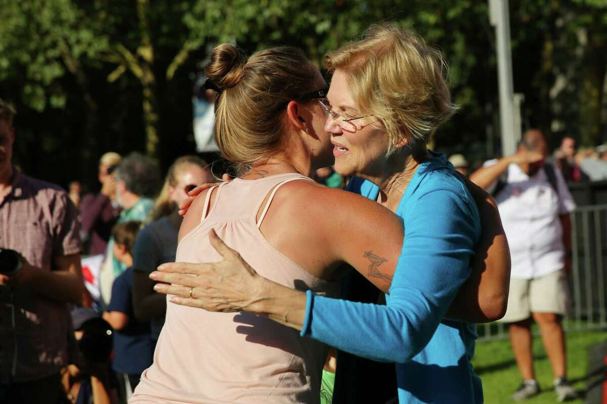 Democratic presidential candidate Senator Elizabeth Warren hugs a woman after taking the 50,000th selfie of her campaign with her after a town hall event at Seattle Center, Sunday, Aug. 25, 2019. Warren is the first top tier candidate to hold a campaign event in Seattle.