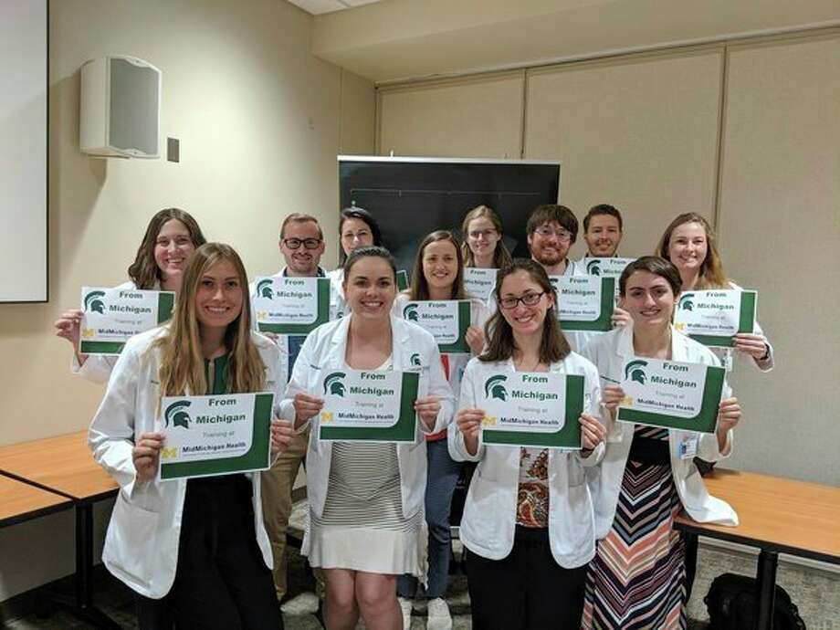 Michigan State University's College of Human Medicine class of 2021 poses for a photo as they enter into their clinical studying at the Midland Regional Campus. (Photo provided)