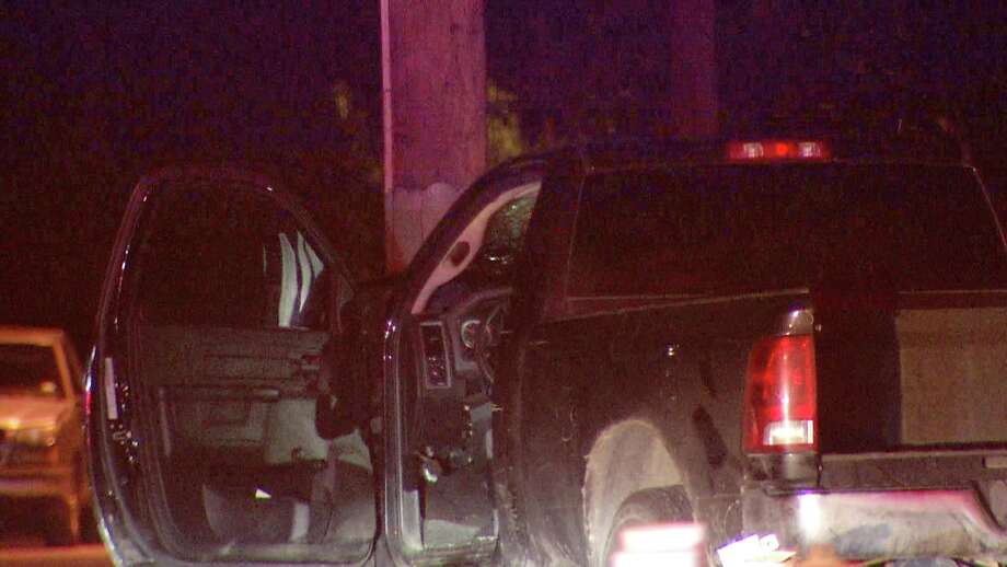 San Antonio police detained a man overnight after he crashed his truck into a utility pole near the St. Mary's strip, authorities said. Photo: Ken Branca