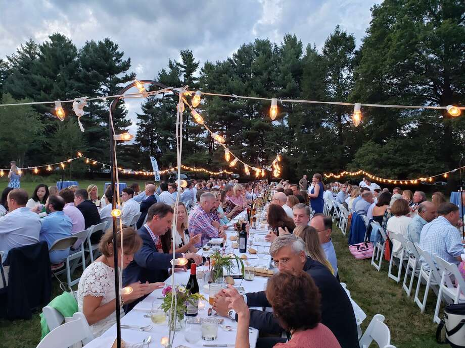 More than 250 people ate by candlelight at the Darien Land Trust's fifth annual Farm to Table Dinner on Saturday, Aug. 24. Photo: Sandra Diamond Fox / Hearst Connecticut Media / Connecticut Post