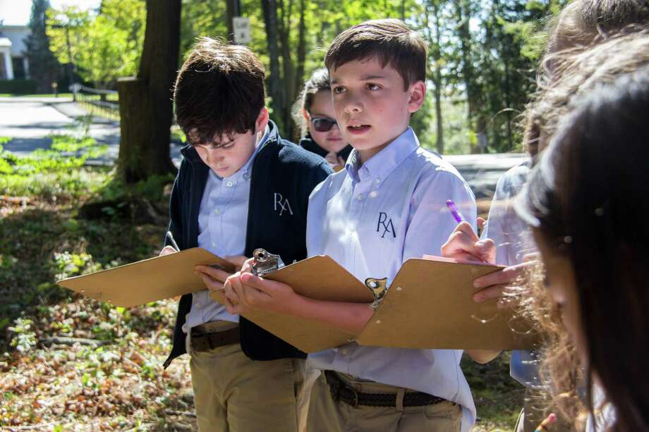 Ridgefield Academy students take notes while learning outdoors. Photo: Ridgefield Academy