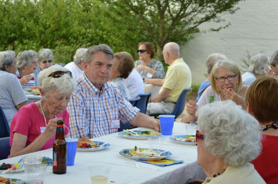 Stay at Home in Wilton member and volunteer driver Phil Stevens enjoys a picnic dinner at the group's barbecue on Aug. 16. Photo: Debbie Louis / Stay At Home In Wilton / Wilton Bulletin Contributed