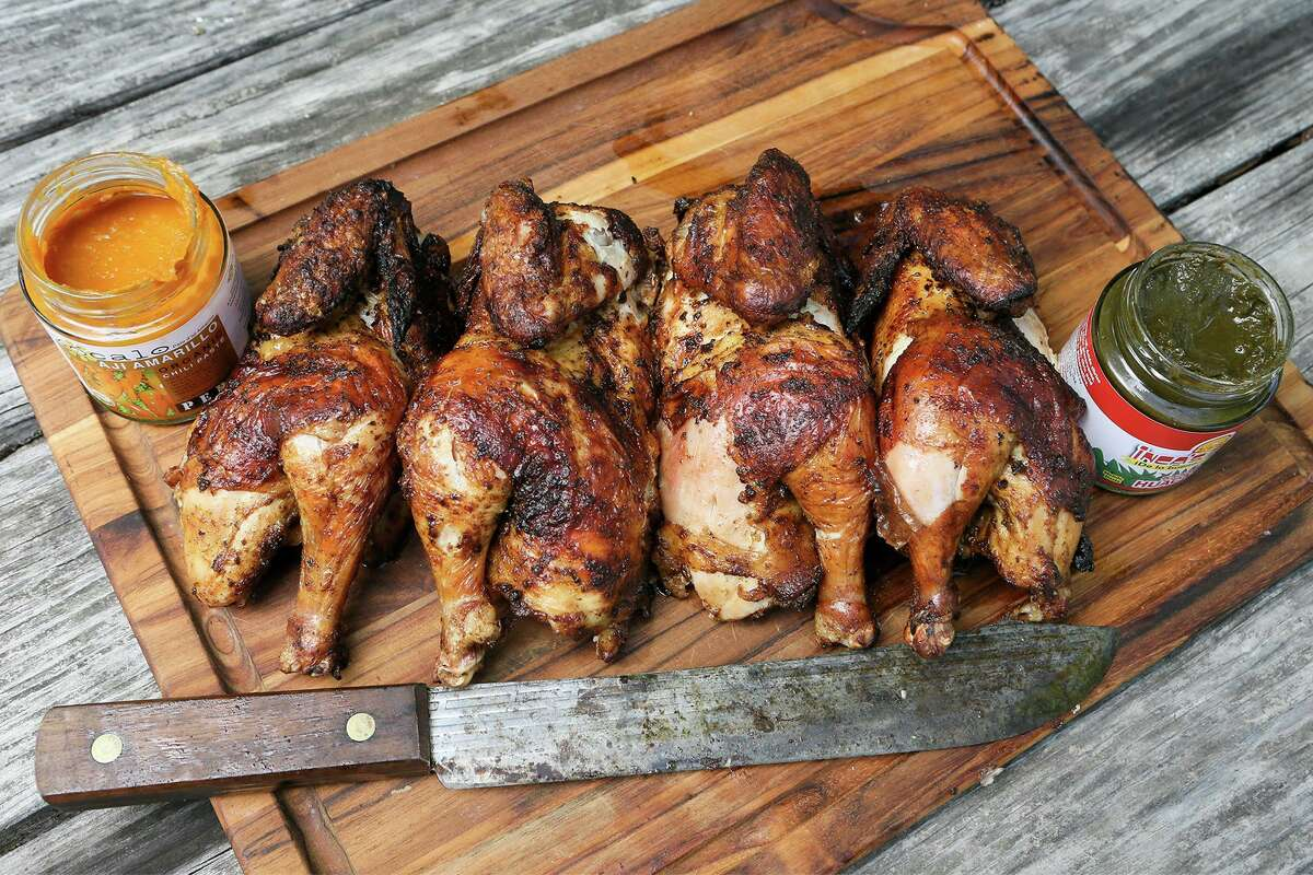 Peruvian-style chicken, known for its marinade and flavor, is prepared fresh off the grill at Chuck's Food Shack.