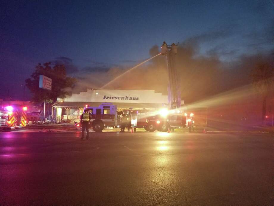New Braunfels firefighters work to extinguish a blaze that started behind the Friesenhause Restaurant on Aug. 23. The restaurant was a total loss and will be closed indefinitely. Photo: New Braunfels Police