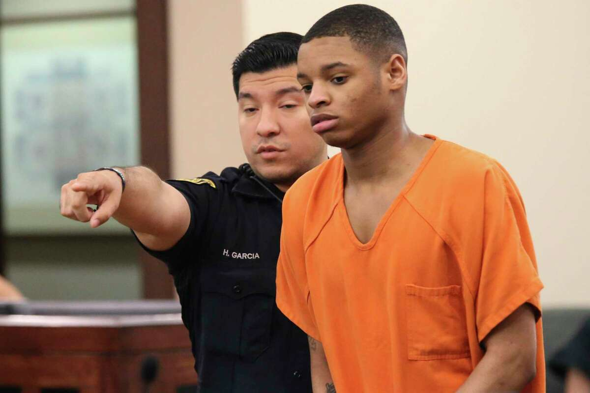 Anton Harris is led into court Monday. He is accused of raping multiple women and robbing several others at either gun or knifepoint in and around San Antonio's South Texas Medical Center area.