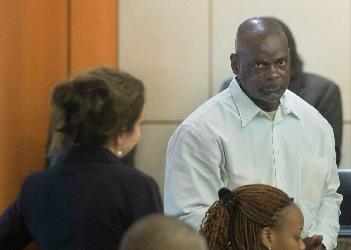 Former Houston Police Department narcotics officer Gerald Goines talks to his defense attorney Nicole DeBorde while appearing before Harris County Judge Frank Aguilar on Monday, Aug. 26, 2019, in Houston. Goines is charged with felony murder in deaths of Dennis Tuttle and Rhogena Nicholas in a botched drug raid in January.