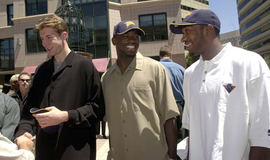 New Warriors Troy Murphy, Jason Richardson and Gilbert Arenas work their way through the crowd on the way to the Golden State Warriors' introduction of their draft picks at an outdoor press conference at City Center Plaza in Oakland on June 28, 2001. Photo: MediaNews Group/Contra Costa Tim/MediaNews Group Via Getty Images