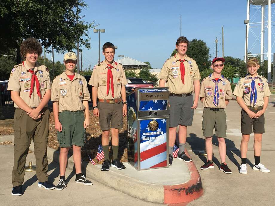 Members of Boy Scout Troop 73 attended the Aug. 24 dedication ceremony organized by Katy American Legion Post and Auxiliary 164 at the Katy Branch Library for the drop box for American flags. From left are Colten Couet, Max Ashabranner, Emilio Lyle, Shawn Couet, Ethan Stirrup and Russell Leach. Photo: Karen Zurawski / Karen Zurawski