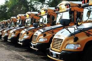City of Shelton school buses parked in Shelton, Conn. June 7, 2018.