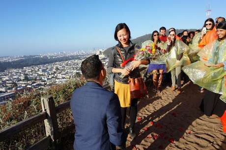 Peter Movilla proposes to Jennifer Wang atop the 16th Avenue tiled steps. The couple met in an UberPool.