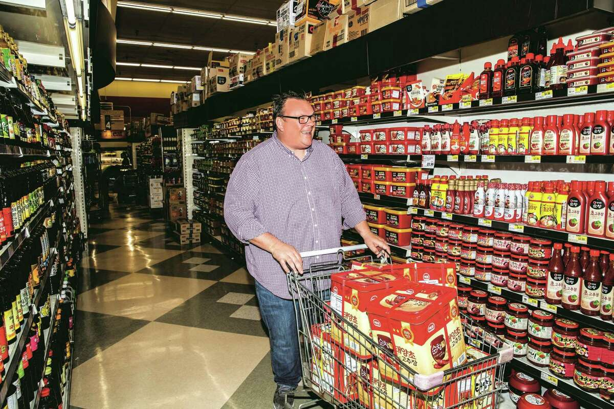 """Chef Chris Shepherd shops in his favorite H Mart store for the gochujang sauce he prizes. From """"Cook Like a Local,"""" written by Shepherd and co-author Kaitlyn Goalen."""