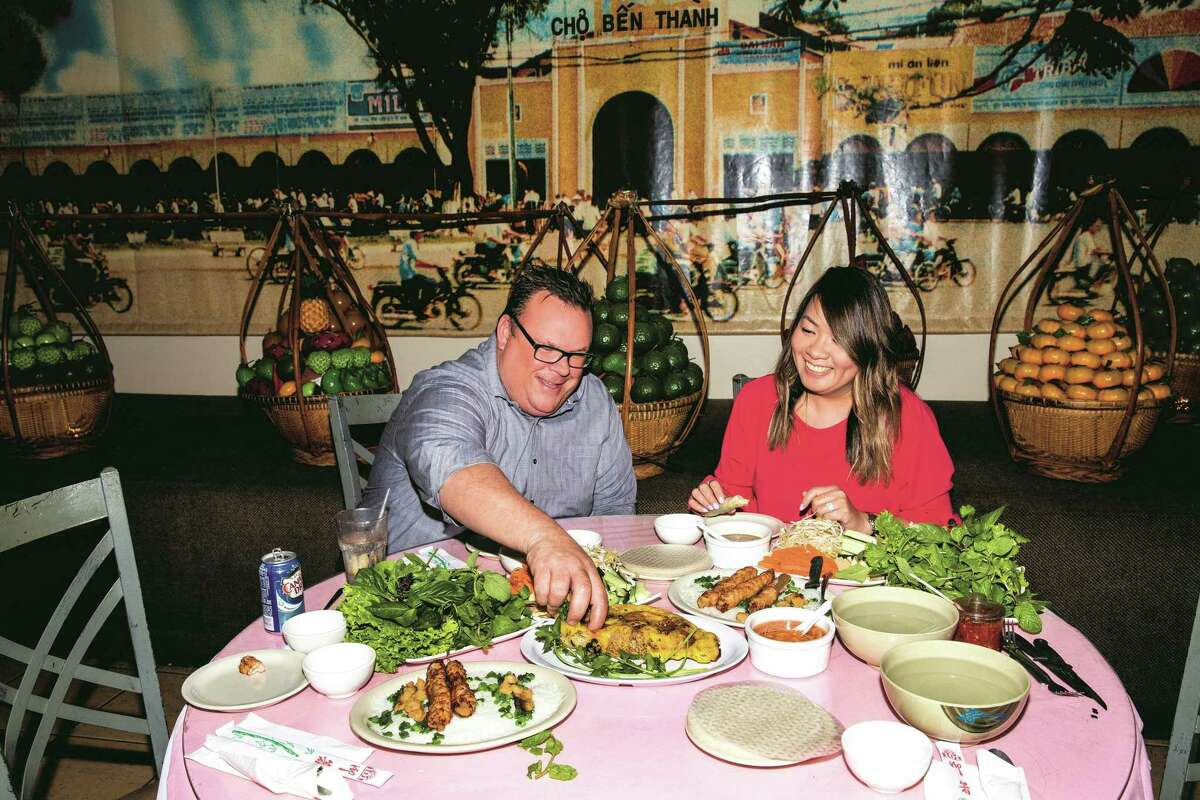 """Chef Chris Shepherd at Saigon Pagolac, a Vietnamese restaurant in Asiatown, with owner Jacklyn Pham, whose father Long Pham opened the restaurant in 1989. From Shepherd's new cookbook, """"Cook Like a Local,"""" written with co-author Kaitlyn Goalen."""