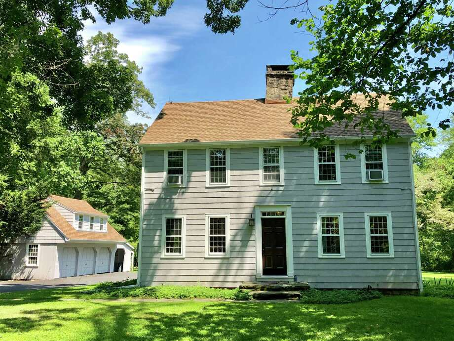 The gray colonial saltbox with white trim at 119 and 121 Weston Road in Lower Weston has eight rooms and a very manageable 1,780 square feet of living space.