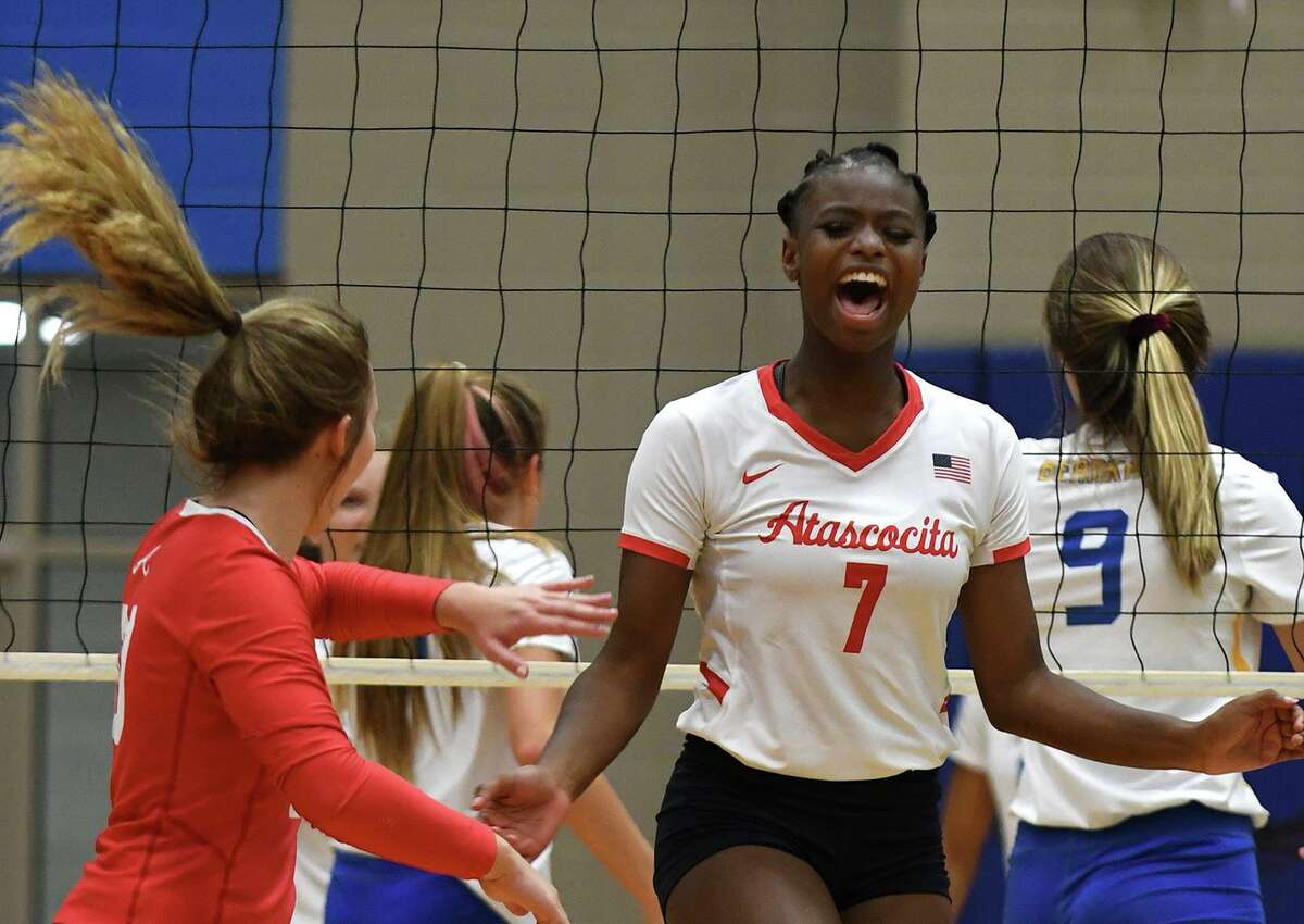 Atascocita senior outside hitter Jaelyn Williams (7) celebrates a point with teammate and sophomore libero Kayden Tanner, left, after a poinyt against Klein during their non-district match at Klein High School on August 20, 2019.
