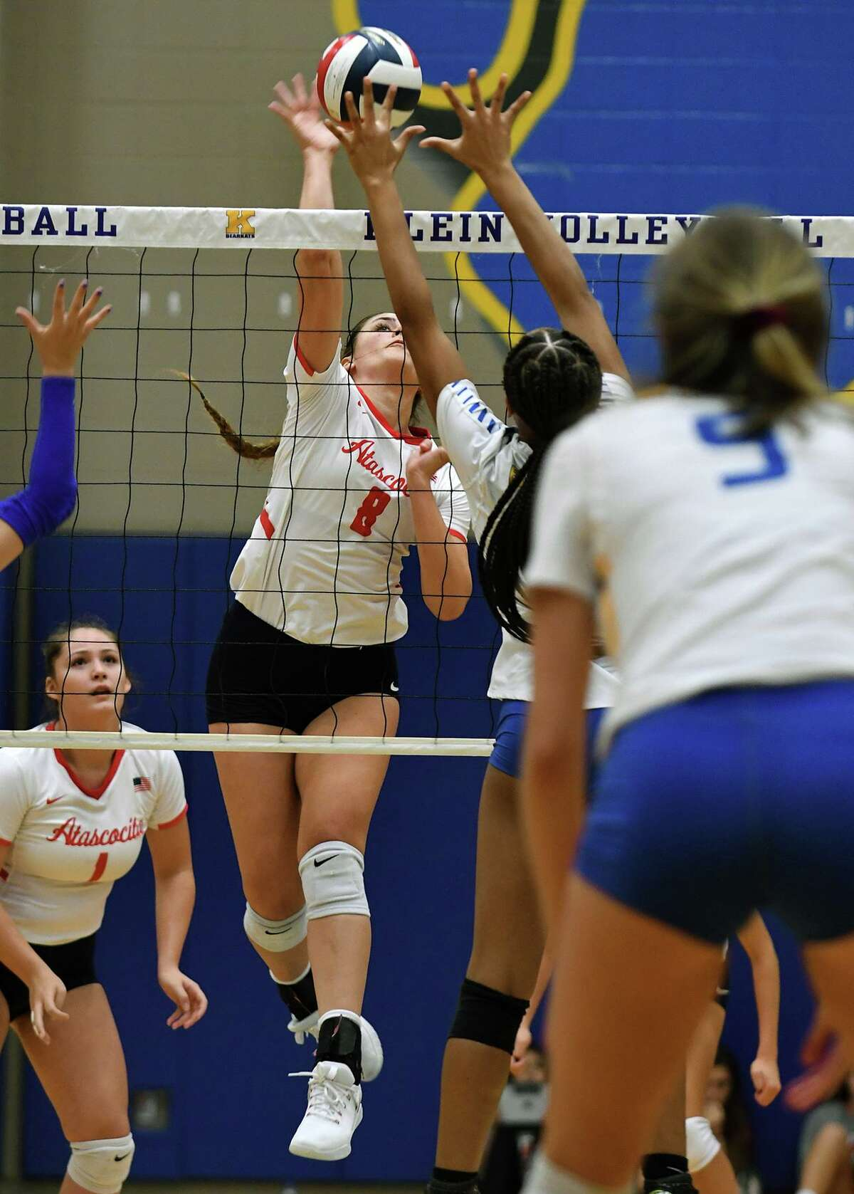 Atascocita junior middle blocker Kenzie Coker (8) battles at the net against a Klein defender during their non-district match at Klein High School on August 20, 2019.
