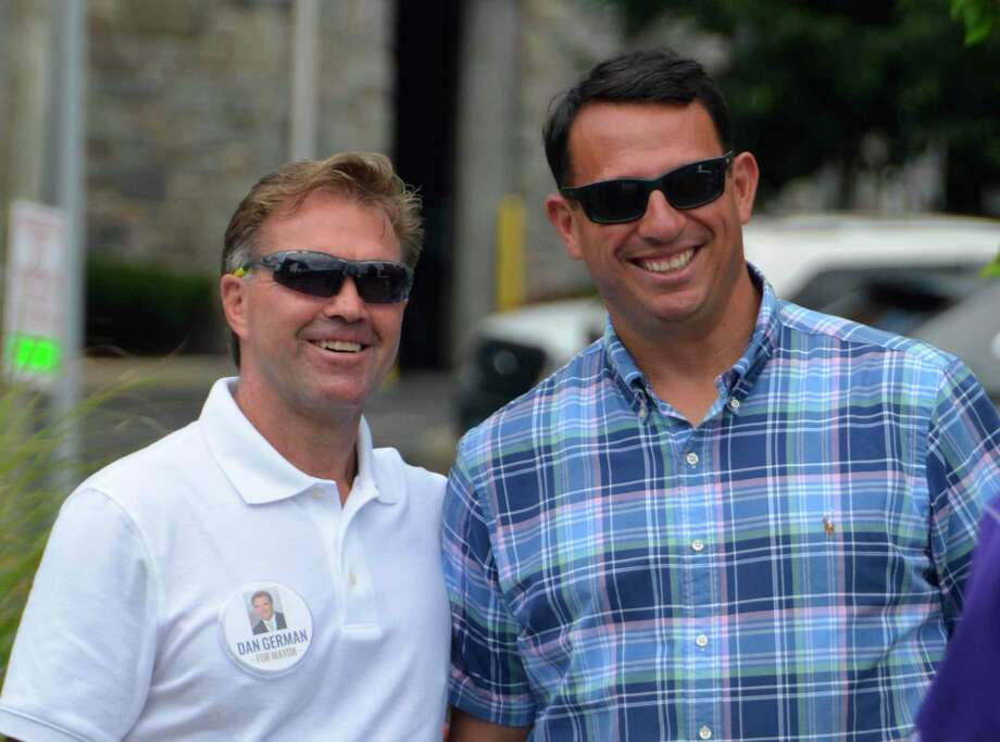 Mayor Ben Blake, Democrat, on the right, and his challenger in the 2019 election, Dan German, Republican, pictured here at the Annual Milford Oyster Festival Aug. 17, 2019. The two will debate at the Plymouth Men's Club in September. Photo: Jill Dion / Hearst Connecticut Media