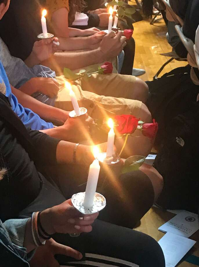 Albertus Magnus College on Monday held its annual college-wide convocation and candlelight service, the school's oldest tradition, according to a release. Photo: Contributed Photo