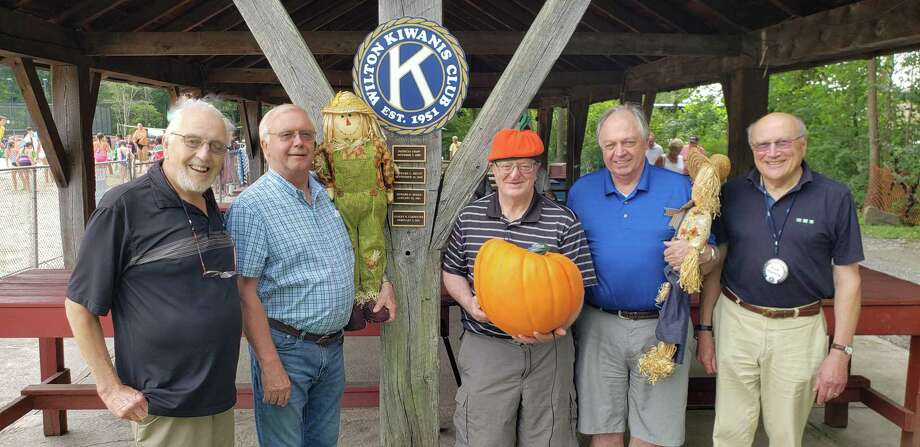 From left, Kiwanis Club members Bud Taylor, Ray Tobiassen, Dan Mahoney, Den Taylor and Rudi Hoefling get ready for the club's annual delivery of pumpkins. The pumpkin sale starts Saturday, Sept. 28, 2019, at the Wilton Historical Society, 224 Danbury Road, in Wilton, Conn. Photo: Contributed Photo / Wilton Kiwanis Club / Wilton Bulletin Contributed